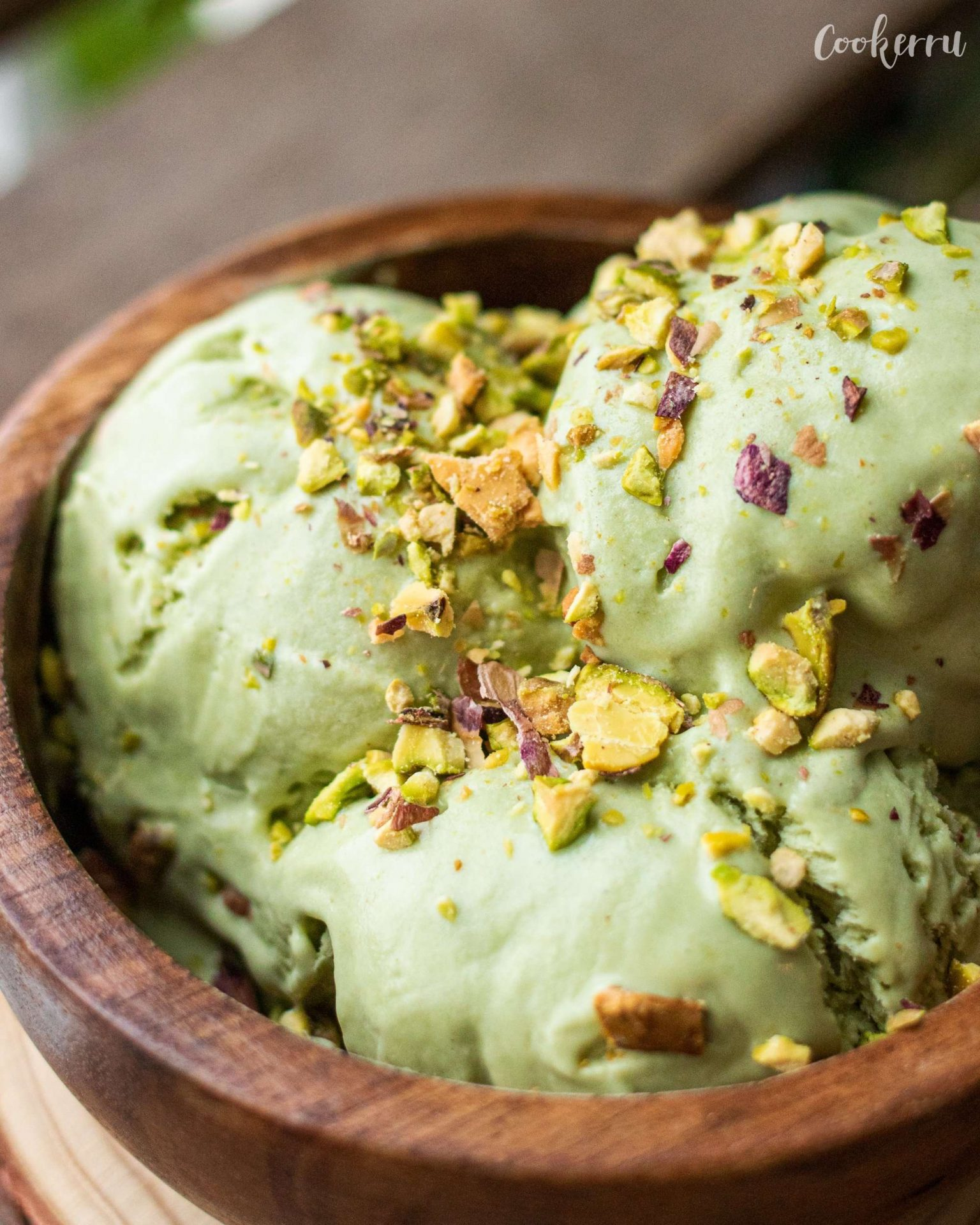 matcha ice cream with chopped pistachios on top